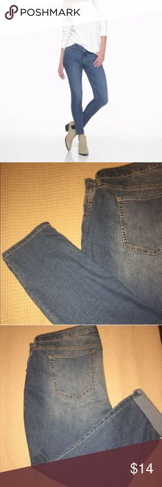 Super skinny mid rise old navy jeans Sits just above the waist. Snug through hip and thigh. Button closure and zip fly. Scoop pockets and coin pocket in front; patch pockets in back. Soft, medium-weight denim with added stretch.Straight skinny leg. 74% cotton, 15% polyester, 10% viscose rayon, 1% spandex. Old Navy Jeans Skinny