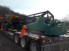 John Deere 920 header salvaged for used parts. This unit is available at All States Ag Parts in Ft. Atkinson, IA. Call 877-530-3010 parts. Unit ID#: EQ-23574. The photo depicts the equipment in the condition it arrived at our salvage yard. Parts shown may or may not still be available. http://www.TractorPartsASAP.com