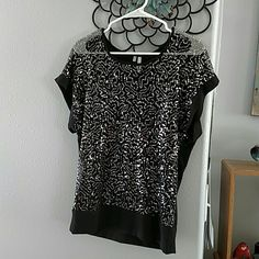 Studio y button back Preworn but still pretty. Silver on black, cute sleeves, longer length, with button down back. See through front. Studio Y Tops