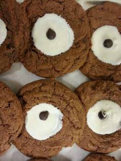 """GINGER AND WHITE CHOC COOKIES 2/3 C. BUTTER 2 C. SUGAR 2 EGGS 2/3 C. MOLASSES 4 C. FLOUR 1 T. GINGER  2 t. B. SODA 2 t. CINNAMON ½ t. GRD CLOVES ½ t. SALT.......TOPPING; 2 C. WHITE CHOCOLATE ½ TSP. CINNAMON CREAM BUTTER & SUGAR, ADD EGGS & MOLASSES, BEAT TIL FLUFFY.SIFT TOGETHER FLOUR, GINGER, B. SODA, SALT, CLOVES AND CINNAMON, ADD TO BUTTER MIXTURE. COOL FOR 1 HOUR, MAKE INTO 1"""" BALLS, BAKE @ 350 FOR 12 MIN.,  MAKE A DENT IN THE MIDDLE.MELT CHOC. & CIN, SPOON ABOUT ½ TSP. ON TOP OF COOKIE 4 C's, Cream Butter, 2 Eggs, White Chocolate, Soda, Balls, Cinnamon, Middle, Cookies"""
