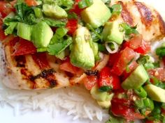 Healthy and Tasty. Great for Summer. Coriander And Lime Chicken With Avocado Recipe 8 boned chicken thighs 2 tbsp. olive oil 1 lemon juice and grated rind 2 tsp. ground cumin 2 garlic cloves, crushed 1 tbsp. clear honey Salt and pepper to taste 1 tomato, chopped 2 large avocados 3 tbsp. fresh coriander, chopped