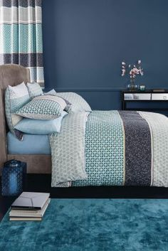Wishing away the cold weather? Add a bit of spring to your bedroom by incorporating refreshing blue tones.