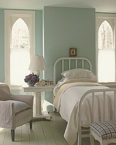 Simple pretty guestroom. Don't like the bed frame