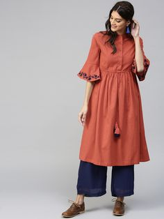 Buy SASSAFRAS Brown Bell Sleeve Solid A-Line Kurta online in India at best price.Rust brown solid A-line kurta with tie-up along the waist, has a mandarin collar, three-quarter sleeves, Simple Kurta Designs, Stylish Dress Designs, Designs For Dresses, Stylish Dresses, Stylish Kurtis Design, Pakistani Dresses Casual, Indian Fashion Dresses, Dress Indian Style, Fashion Outfits