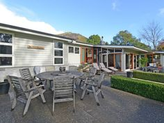 One of a kind!    Bordering the greens and fairways of picturesque Te Marua Golf Course nestled in privacy and sunshine is this magnificent beautifully renovate...