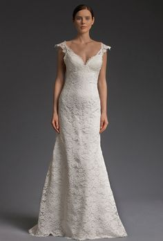 """Brides: Victoria Kyriakides. """"Lacy Cream"""" wedding dress from cordone lace and buttons down the sheer tulle low back. A modern twist to classic lace!"""