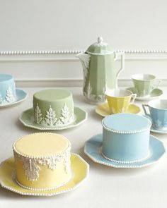 "Tea Party Mini Wedding Cakes Whether you're hosting a five-course meal at an old estate or midday brunch in a ballroom, these miniature cakes, modeled after Nymphenburg's ""Pearl"" tea service, are as pretty and delicate as they come. Ben-Israel covered each one with pastel fondant, then attached molded sugar paste and piped on royal icing. Present three different colors per table"