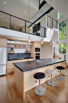 high ceilings | three-story minimalist house with a small footprint | Crane Residence by Spore Architecture
