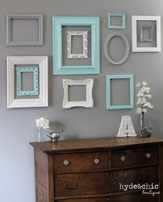 fill the wall at the beach house, cabin, or coastal retreat - inexpensive repainted frames from thrift store - frame layout