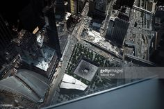 A reflecting pool at the 9/11 memorial site is viewed from the newly built One World Observatory at One World Trade Center on May 22, 2015 in New York City. The observation deck sits atop the 104-story skyscraper at the former site of the Twin Towers, opening to the public on May 29th with tickets currently being sold online.