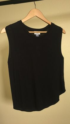 """Black Muscle Blouse NWT New with tags. Super soft light weight and smooth on skin, 100% Rayon. Muscle sleeve blouse. Slightly tight on my chest b/c I bought a size smaller than my usual. Can try on or measure if requested. Here are my measurements for a guide:    MY MEASUREMENTS  ------------------------  My height: 63"""" - 5' 3""""  Shirt: M/L  Pants: 13 woman's size / 33"""" in / L-XL / Petit/Short  Blouse/Dress: 10-13 Petit/Short depends on designer/brand  Torso: 63"""" - 64""""  Chest/Breast: 40""""…"""