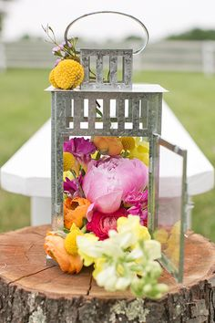 Hot pink and orange garden roses in a lantern | Heidi Geldhauser of Our Labor of Love | Brides.com
