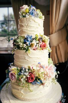 Homemade wedding cake with colorful, country-inspired flowers