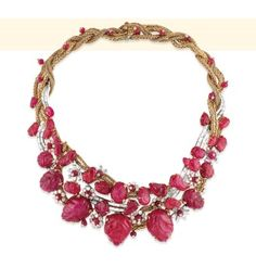 """""""A RETRO RUBY AND DIAMOND NECKLACE, BY MARCHAK Designed as interlacing gold ropework or baguette-cut diamond lines, enchanced by diamond and ruby flowers, ruby beads and carved ruby leaves, 1940s, inner circumference 35.0 cm, with French assay marks for platinum and gold Signed Marchak"""" © Christie's (quote) via christies.com"""