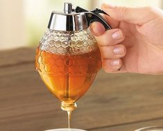 A sophisticated alternative to those pudgy plastic honey bears, this honey dispenser releases a thin drizzle of honey into your tea or steamed milk or on top of toast, hot cereal, pancakes or cornbread. - http://thegadgetflow.com/portfolio/no-drip-honey-dispenser/