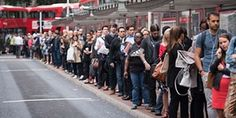 <strong>London, UK</strong> Commuters queue for buses