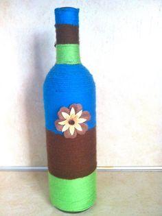 Yarn wrapped wine bottle by OllieEyes on Etsy, $10.00