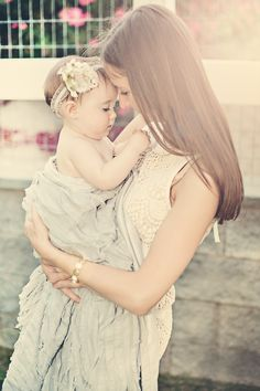 Mother and baby girl special moment.  Lace dress, gray ruffle blanket, vintage lace headband.  NessaBPhotography
