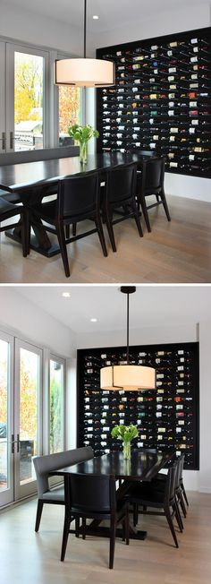 Wine Rack Ideas - Show Off Your Bottles With A Wall Mounted Display | This large wall mounted display in black lets the colors of the labels really stand out and eliminates the need for a statement art piece.