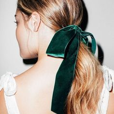 BEAUTY • obsessed with the low pony velvet bow • @coveteur • Notes from the experts: Before you make your low ponytail, back-comb the roots at the crown to get height, then use an elastic, which you'll soon cover with a ribbon. To get the perfect bow, loop one side and wrap the other side around it, keeping the underside hidden. To bring out a few soft bits around the ears, rub your hair at the temples.  #Regram via @oui_events