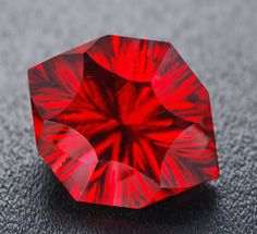 Crown of Fire Photo by Robert Weldon.     Red Beryl was first described in 1904 for an occurrence, its type locality, at Maynard's Claim (Pismire Knolls), Thomas Range, Juab County, Utah.  Red beryl is very rare and has only been reported from a handful of locations including: Wah Wah Mountains, Beaver County, Utah; Paramount Canyon andRound Mountain, Sierra County, New Mexico.