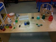 jars, tubes, eye droppers, spoons, sprayers, colored water - many possibilities for creative exploration!