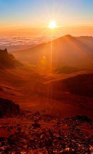 Witness a majestic sunrise atop Mount Haleakala. (Four Seasons Resort Maui) #FSImagination