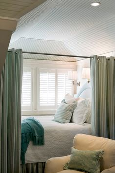 The curtains add some privacy and separates the small room in two areas. I love this idea!  Designed by Historical Concepts.