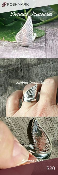 "Silver Angel Wing Ring/ Statement Piece The sleek design of this ring is immediately noticeable for the intriguing look & bright shine. The finely detailed upswept wing measures 1"" at the tallest. Made of silver alloy. #0828-1 Jewelry Rings"