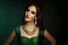 emerald green dress accessorized with gorgeous gemstone encrusted necklace in deep stone shades and jhumki earrings