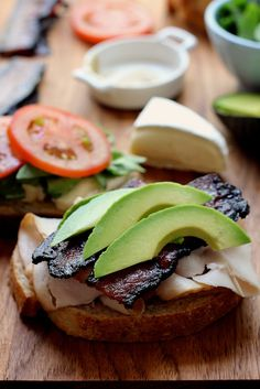 The Ultimate Club Sandwich grilled with avocado and brie.