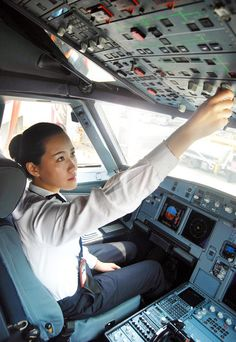 The 25-year-old is the first female civil aviation pilot in the northeastern region of China. Here Li Ying prepares for a flight in the cockpit of a plane in Shenyang.
