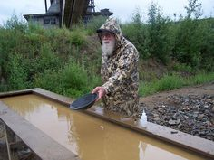 Veteran prospector with gold pan at Chicken