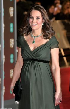 Glittering: The Duchess was glittering with a bright necklace, matching earrings and a chu...