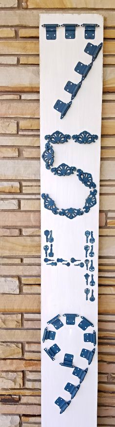 House Numbers using Repurposed Hardware  This DIY project is inexpensive as it uses hardware you have from projects.  This is a great upcycle - reuse idea and takes very little materials to make.  This will add curb appeal to your home.