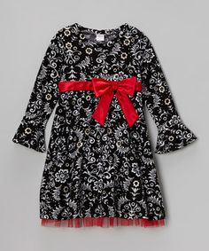 An intricate print makes this fanciful frock the outfit of choice for discerning little ladies. With its peekaboo tulle lining and big satiny bow, this piece is party perfection.