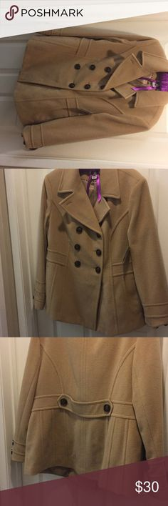 St.John's Bay Beige Coat This is a nice beige coat.   Perfect for winter and when it's gets cold during the spring time.  It's New with Tags.   It's a Cashmere blend.   Fabric contents are 70% Wool, 20% Nylon, & 10% Cashmere.  Thank you for considering my listing.   I hope you purchase.   Have a good day. St. John's Bay Jackets & Coats Blazers