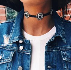 Western vibes with this black and silver concho choker