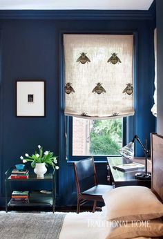 """Deep blue walls make for a cozy space, while Timorous Beasties' quirky """"Napoleon Bee"""" fabric adds an element of surprise. - Photo: Jessica Glynn & Nick Johnson / Design: Blair Harris"""