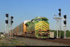 The Illinois Terminal Heritage Unit leads NS train 31M past the old and new signals at CP 352 in Edgerton, OH in early evening light.