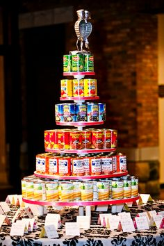 Have everyone bring a can of food, stack in the shape of a wedding cake, and…