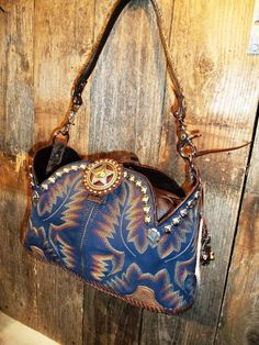 Refurbished Old Cowboy Boots Into This Amazing Leather Handbag