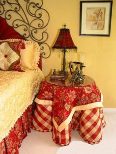 would love in Blue.....Basic plaids in a primary color are a classic in French Country design.  The bright color is punctuated by black accents.  Here, a combination of patterns and textures add interest.