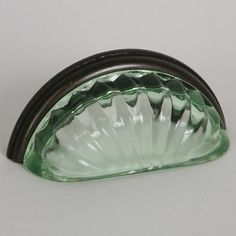 This transparent green glass cabinet/drawer cup pull with melon design is part of the Melon Glass Bin Pull Series from Lew's Hardware. A hand poured glass bin pull with an oil rubbed bronze finish die cast zinc base. Perfect for use on cabinet doors and drawers capable of accepting a mounted pull, the melon glass design transforms the classic all metal fabrication into a unique transitional design with equal use within traditional and modern settings.