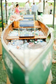 An old canoe filled with beverages is great party decor