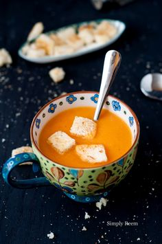Tomato Soup (simply reem) -- Super simple recipe. Omitting the butter and cream for vegan version, it's only got onion, garlic, ginger, s, sugar and some oil.
