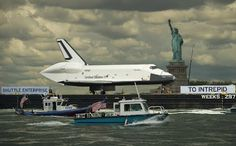 NASA - Google+ - The space shuttle Enterprise, atop a barge, passes the Statue of Liberty in New York on its way to the Intrepid Sea, Air and Space Museum where it will be permanently displayed, Wednesday, June 6, 2012. Photo Credit: (NASA/Bill Ingalls)    スペースシャトル・エンタープライズ号が、ニューヨークのイントレピッド航空宇宙博物館に到着。途中で自由の女神からの出迎えを受けています。