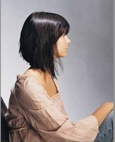 a-line lob with bangs. Her hair is so pretty and straight and shiney...would never work on my hair.