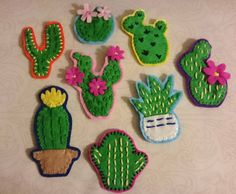 Handmade felt cacti brooches / badges! Each measures about 2-3 inches tall. Each has a safety pin attached to the back for easy attachment to your