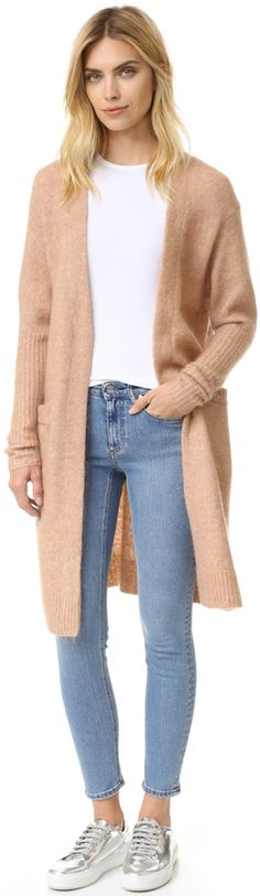 A fuzzy, oversized Acne Studios cardigan sweater is just what your outfit needs.
